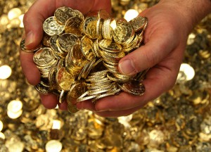 An employee at Belgium's Royal Mint scoops up a handful of fifty-euro-cent coins in Brussels December 8, 2011. European Union leaders will discuss proposals for tighter euro zone integration on December 8-9, with the aim of bringing deficits and debt much more strictly into check, a move that may give the European Central Bank room to step up purchases of sovereign bonds and reassure financial markets. REUTERS/Yves Herman (BELGIUM - Tags: BUSINESS) - RTR2V05N
